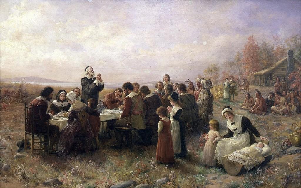 """Primul Thanksgiving a avut loc în toamna lui 1621 şi a durat trei zile, potrivit istoriei americane. Aceasta este o pictură semnată Jennie Augusta Brownscombe şi intitulată """"The First Thanksgiving at Plymouth"""" (""""Primul Thanksgiving la Playmouth"""")."""