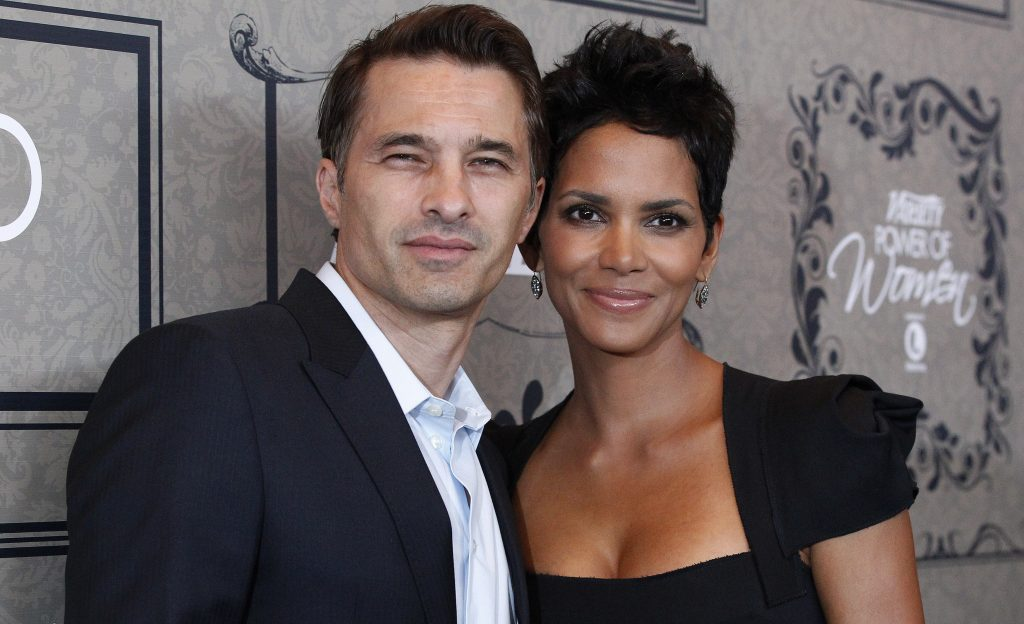 Actress Halle Berry and partner Olivier Martinez pose at Variety's 4th Annual Power of Women event in Beverly Hills